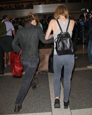 Lily-Rose Depp was spotted at LAX carrying a stylish black leather backpack.