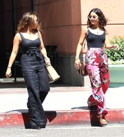 Stella Hudgens rocked a low-cut black jumpsuit while visiting a doctor's office.