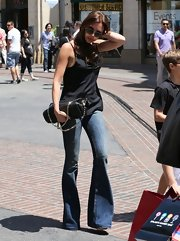 Victoria Beckham balanced out her wide-leg flares with a spaghetti strap tank.