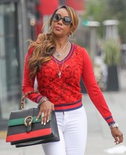 Vivica A. Fox accessorized with a pair of butterfly sunglasses while filming her show in Beverly Hills.