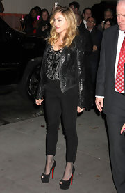 Madonna looked positively ageless at the 'W.E.' screening in a pair of black cigarette pants and towering Christian Louboutin pumps.