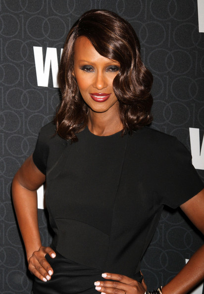 Iman wears a gunmetal eyeshadow to go with her little black dress at the WWD Anniversary Gala.
