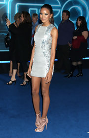 Elizabeth Mathis looked divine in nude Fei peep-toe boots. The peep-toes were an unexpectedly sexy addition to her silver sequined body con dress.