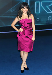 Ana wears a vibrant strapless cocktail dress in a lovely fuchsia hue.