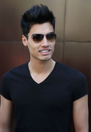Siva Kaneswaran's aviator sunglasses added an air of mystery and style to his whole appearance.