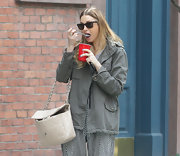 Whitney Port showed off her city style while strolling in NYC. She paired her army green jacket with a quilted leather chain bag.
