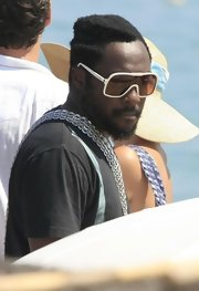 Will.I.AM showed off his white designer shield sunglasses while hitting Club 55 in Saint Tropez.