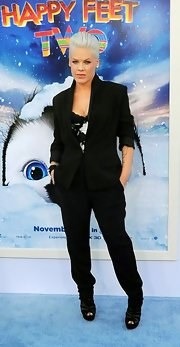 Pink opted for a sleek menswear aesthetic at the premiere of 'Happy Feet Two' in a sharp black suit and a white bustier.