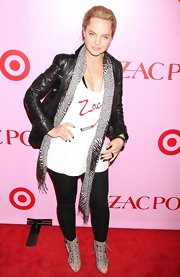 The actress wore a peep-toed pair of gray lace-up ankle boots with black skinny jeans and a Zac Posen tank.