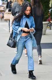 Zoe Kravitz completed her funky attire with black suede and leather lace-ups.