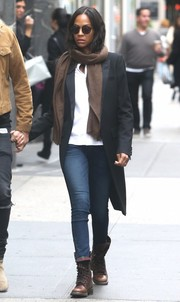Zoe Saldana bundled up in a black wool coat and a brown scarf for a day out in New York City.
