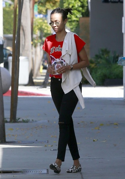 Zoe Saldana sealed off her look with a pair of animal-print smoking slippers.