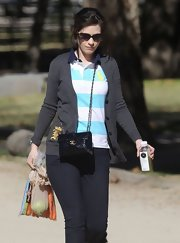 Zooey went for a stroll in this gray knit cardigan with an embroidered front pocket.