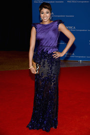 Alicia Quarles chose a purple gown with a sheer, beaded skirt and cap sleeves for the White House Correspondents' Association Dinner.