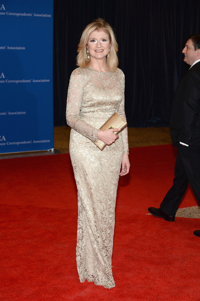 Arianna Huffington chose a metallic gold snakeskin clutch to pair with her gown.