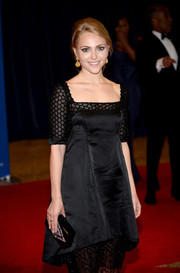 AnnaSophia Robb attended the White House Correspondents' Association Dinner carrying an embellished black box clutch by Edie Parker.