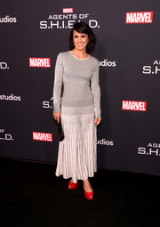 Constance Zimmer donned a maxi dress printed with horizontal and vertical stripes for the 'Agents of S.H.I.E.L.D.' 100th episode celebration.