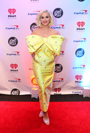 Katy Perry looked cute and festive in a strapless, crystal-studded yellow gown with oversized bow detailing during 101.3 KDWB's Jingle Ball 2019.