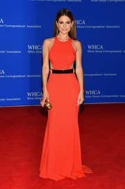Maria Menounos was sexy-glam at the White House Correspondents' Association Dinner in a red-orange Stella McCartney gown with sheer side panels and a gold belt.