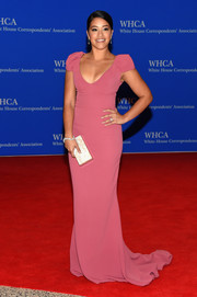 Gina Rodriguez kept up the minimalist-elegant vibe with a pearlized box clutch by Edie Parker.