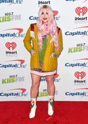 Kesha attended 102.7 KIIS FM's Jingle Ball 2017 wearing a Western-inspired mustard blazer with a red yoke and fringe detail.