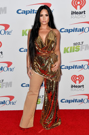 Demi Lovato looked radiant in a draped gold sequin top by Frolov during 102.7 KIIS FM's Jingle Ball 2017.