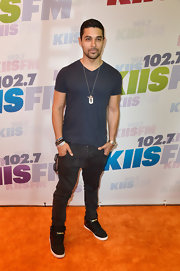 Wilmer Valderrama chose a navy blue basic tee to keep his look casual and relaxed at Wango Tango.