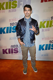 Joe Jonas' satin athletic jacket had a cool retro vibe to it at the Wango Tango event in California.