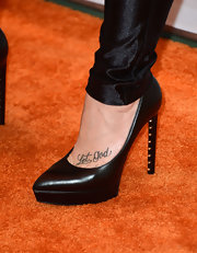 Demi Lovato chose a pair of classic black pumps with a cool modern twist with gold studs inside the heels.