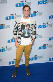 Kendall Schmidt's striped cardigan gave him that sweet school boy look.