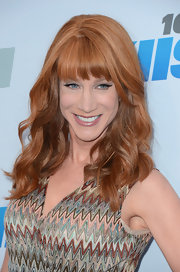 Kathy Griffin wore her vibrant tresses in long layered waves with lash-grazing bangs.