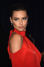 Adriana Lima highlighted her gorgeous face by pulling her hair back into a curly ponytail for the White House Correspondents' Association Dinner.