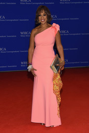 Gayle King went the sweet route in a pink one-shoulder gown with rosette detailing during the White House Correspondents' Association Dinner.