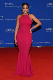 La La Anthony dressed up her curves in a fuchsia mermaid gown for the White House Correspondents' Association Dinner.