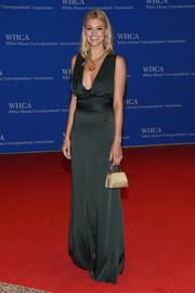 Kelly Rohrbach donned a low-cut forest-green silk gown for the White House Correspondents' Association Dinner.