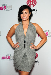 Demi Lovato attended 103.5 KISS FM's Jingle Ball 2014 wearing a stone and tassel pendant necklace by Kendra Scott.