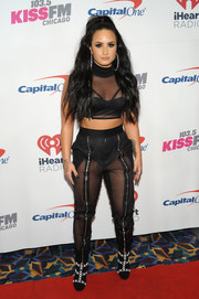 Demi Lovato bared her cleavage and abs in a sheer black crop-top during 103.5 KISS FM's Jingle Ball 2017.