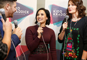Demi Lovato styled her sweater dress with an oversized cage belt for 106.1 KISS FM's Jingle Ball 2015.