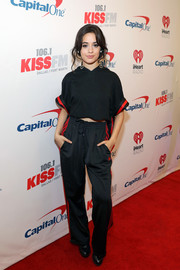 Camila Cabello was sporty in a cropped black hoodie with red trim while attending 106.1 KISS FM's Jingle Ball 2017.