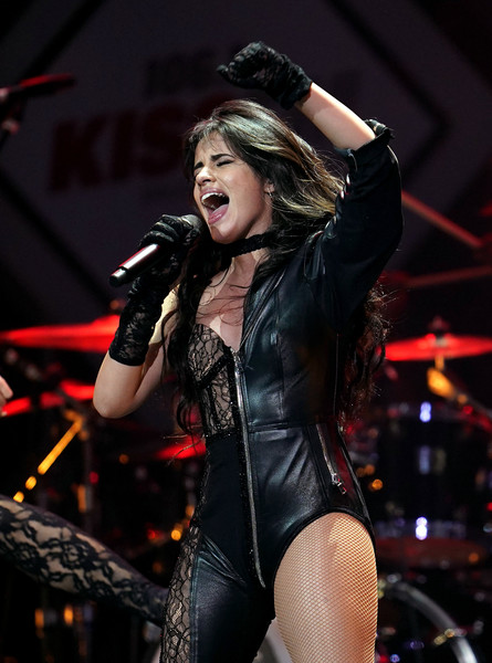 Camila Cabello teamed black lace gloves with a one-leg jumpsuit for her performance at 106.1 KISS FM's Jingle Ball 2019.