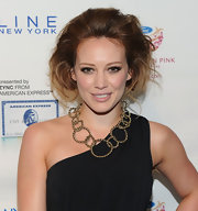 Hilary Duff paired her one-shoulder Diane von Furstenberg dress with a bronze statement neckalce.
