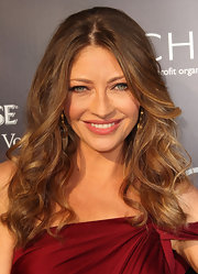 The actress styled her hair in soft curls that were center parted down the center for the Annual Butterfly Ball.