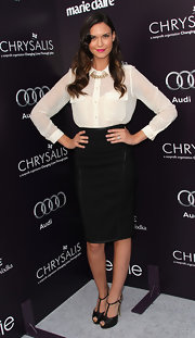 Odette Yustman teamed her sexy secretary style with a pair of black T-strap platforms with gold heels.