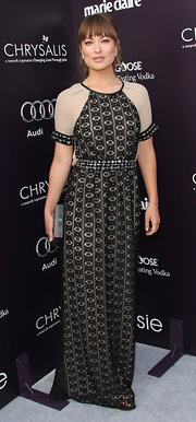 Olivia Wilde paired her exotic embroidered gown with a pewter Stingray Miniaudiere.