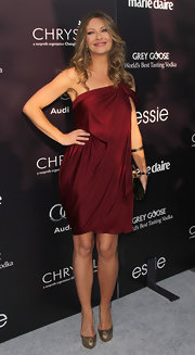Rebecca Gayheard is glowing in a wine off-the-shoulder draped knit dress for the Chrysalis Butterfly Ball.