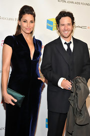 Gina Gershon complemented her elegant dress with a teal satin clutch when she attended the Enduring Vision benefit.