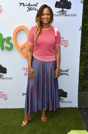 Garcelle Beauvais completed her vibrant outfit with an ankle-length printed skirt.