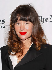 Paz brightened up her look with a punch of glossy red lipstick. The actress paired her pout with a neutral face.