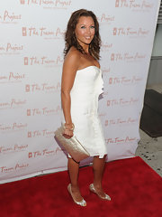 Vanessa looked bright and springy in a strapless white dress with metallic accents, including crinkled peep toe pumps.
