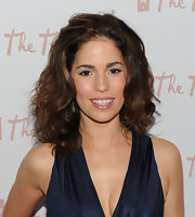Ana Ortiz paired her midnight blue halter dress with medium curls.